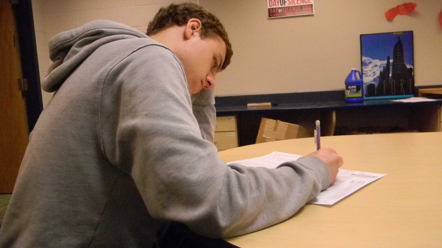 Andrew Hopson '16 taking a test
