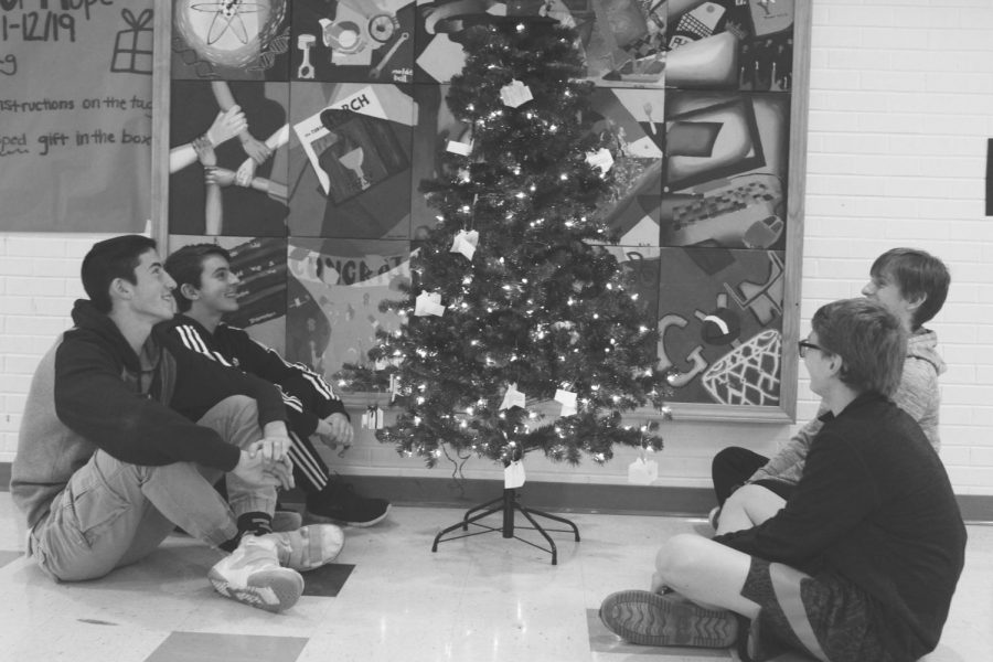 Students gather around the Christmas Tree ready for Christmas