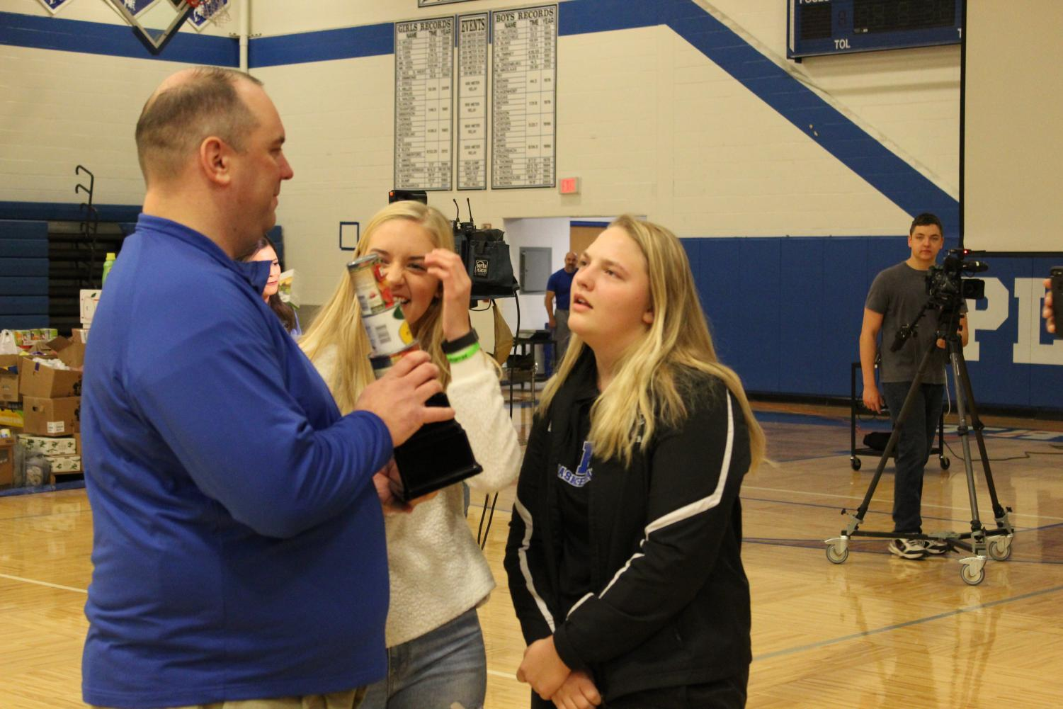 Dr.++Wright+receives+the+trophy+for+Plainwell+crushing+every+school+in+South+West+Michigan+for+food+donations.+