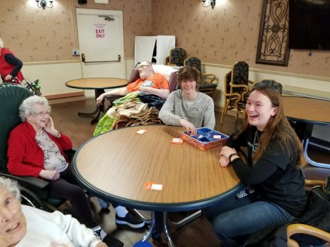 Nikki Rooseboom laughs with her great company at Life Care Center in Plainwell.