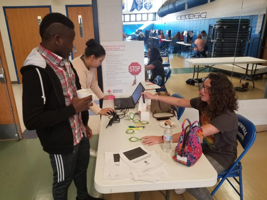 Fellow students signing up for the blood drive.