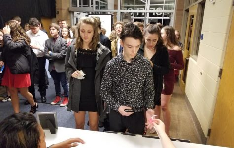 Students Turning in their tickets at last year's homecoming dance