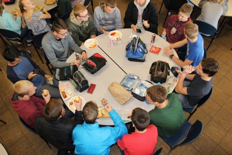 Students socialize at lunch while eating over priced snacks and beverages