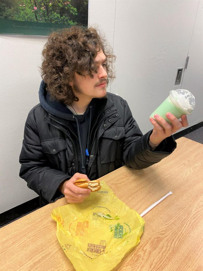 Brennan Dimiceli (Sr) examines his shamrock shake, wondering if the taste is worth the risky ingredients
