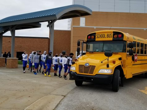 Players Boarding The Bus