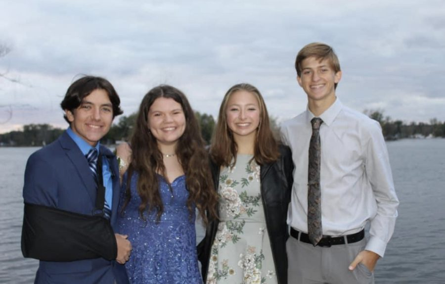 Camden Frederick, Grace Carlyle, Isabelle Delaet, and Dane Jorgenson taking pictures for the dance.